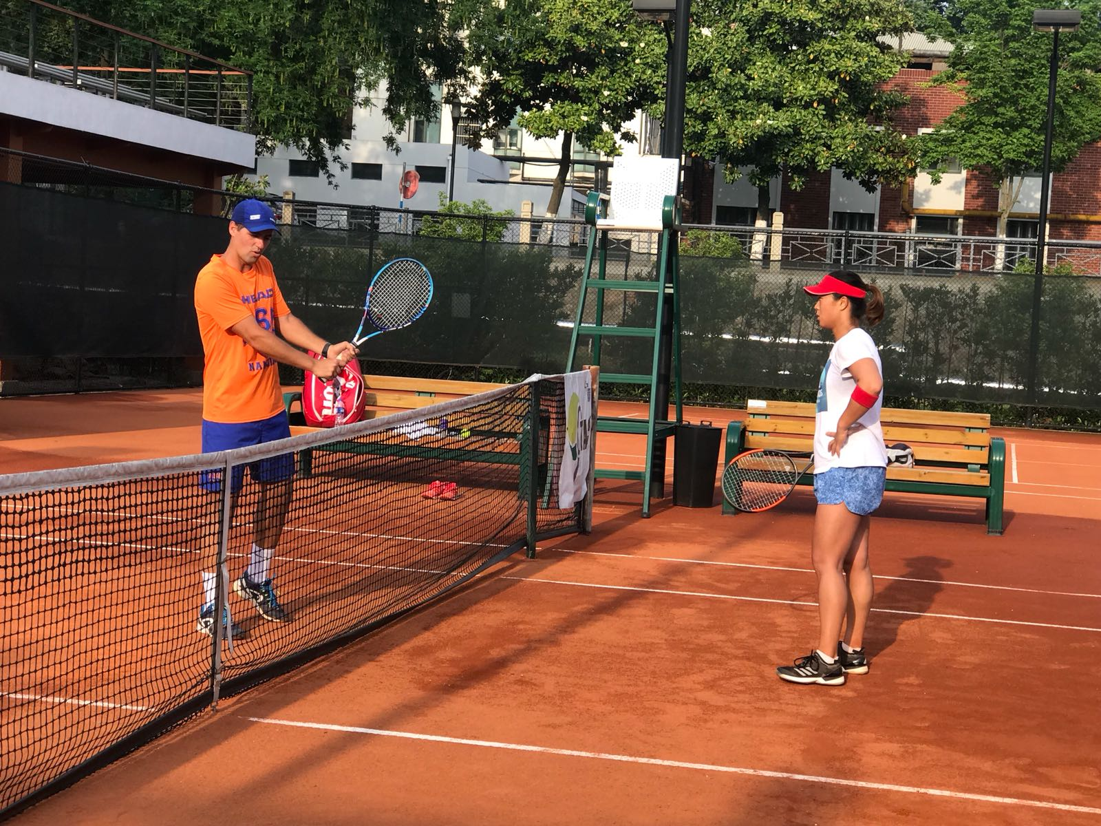 Hector Ruiz on court with student
